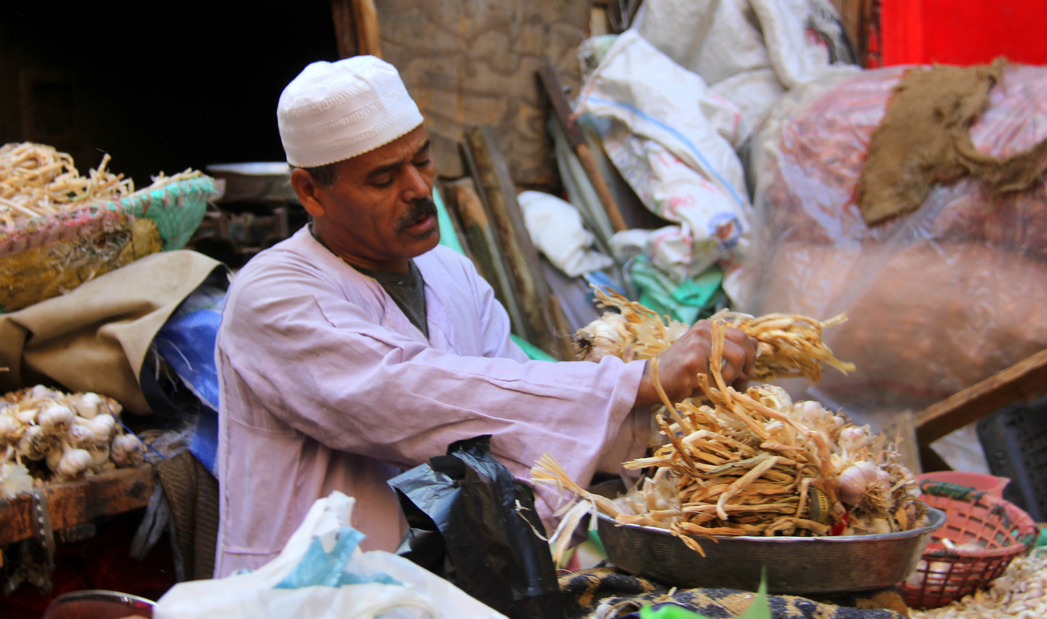 garlic seller at a local market in Cairo