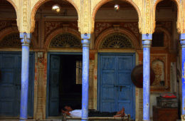 Man resting in a shekhawati haveli