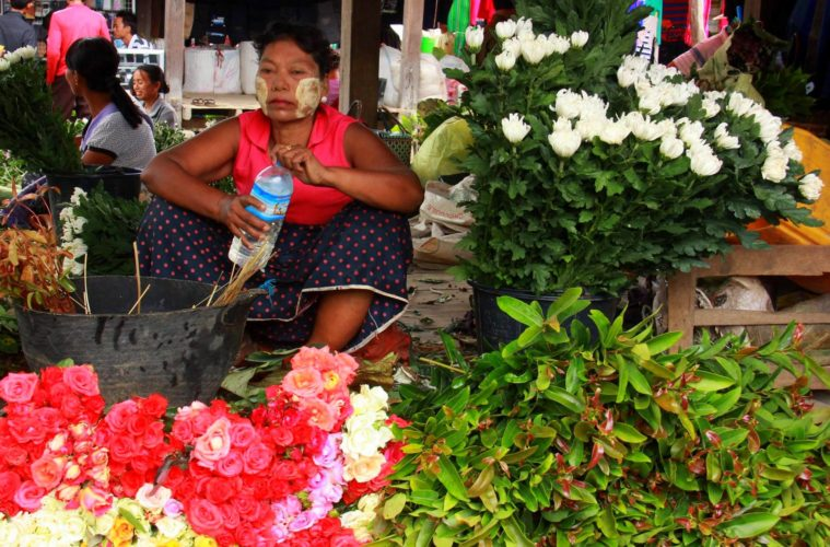 Woman selling flowers at the lake inle weekly markets