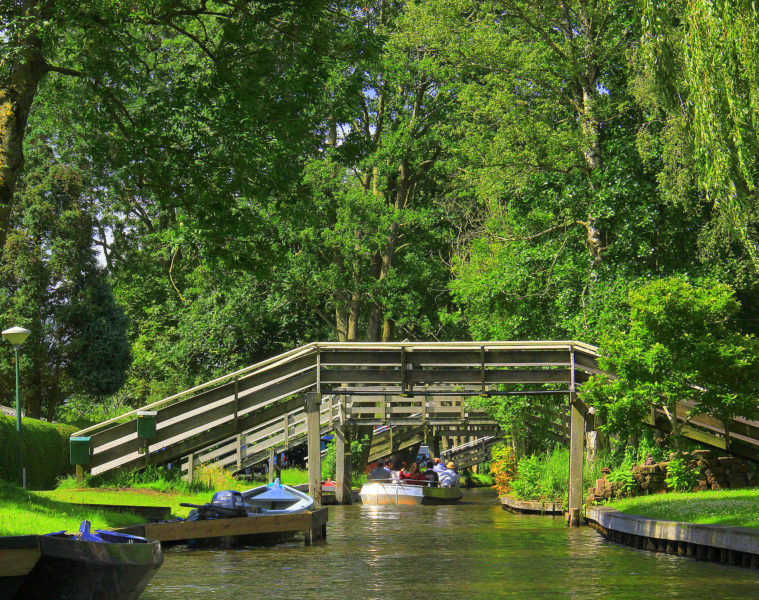 The idyllic canals of giethoorn are crowded in summer