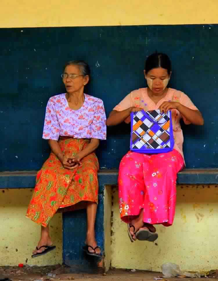 Local Yangon women waiting for train