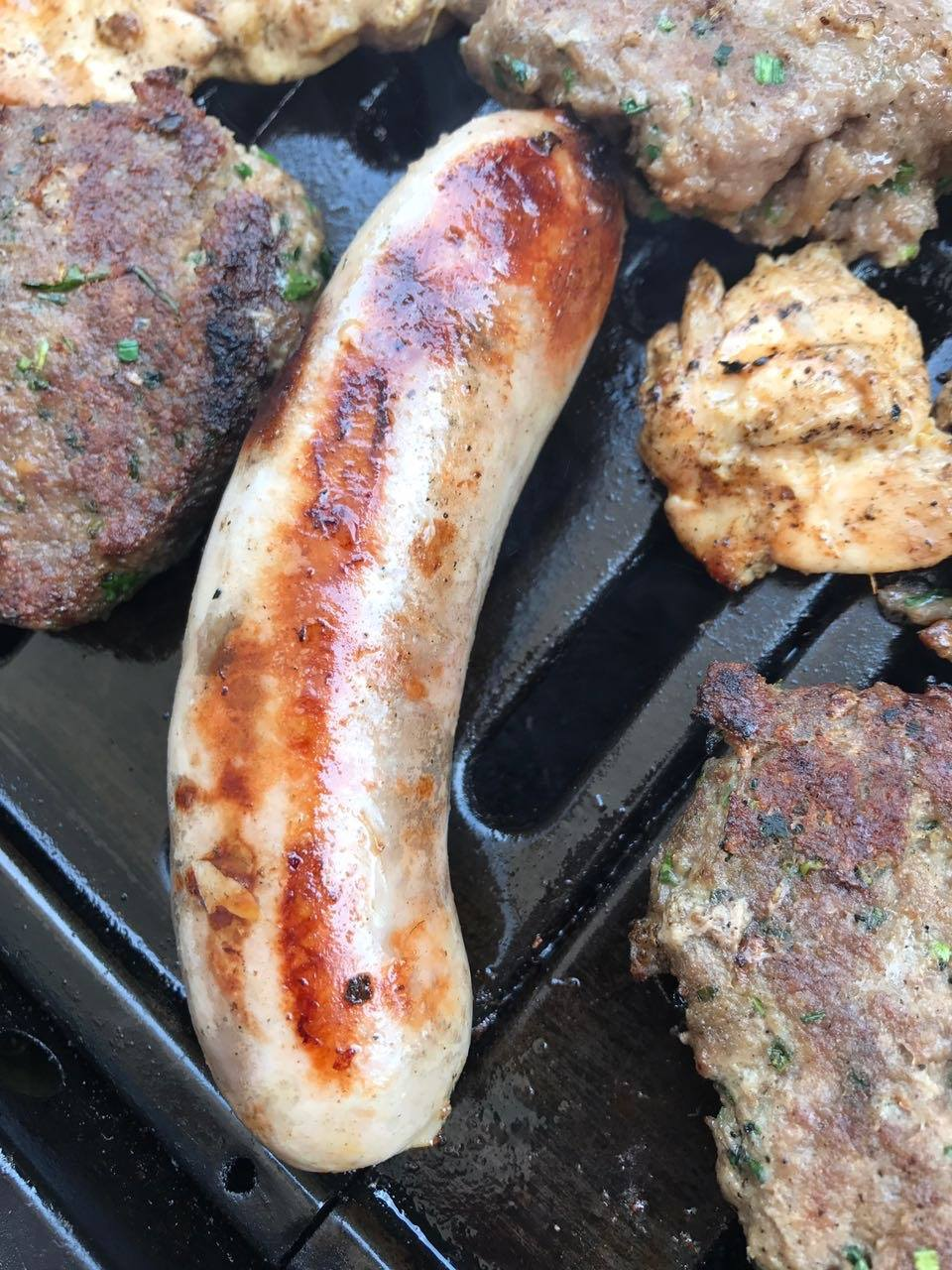 Summer barbecues in Germany mean lot of smoked meat, cold salad, German wurst and beer