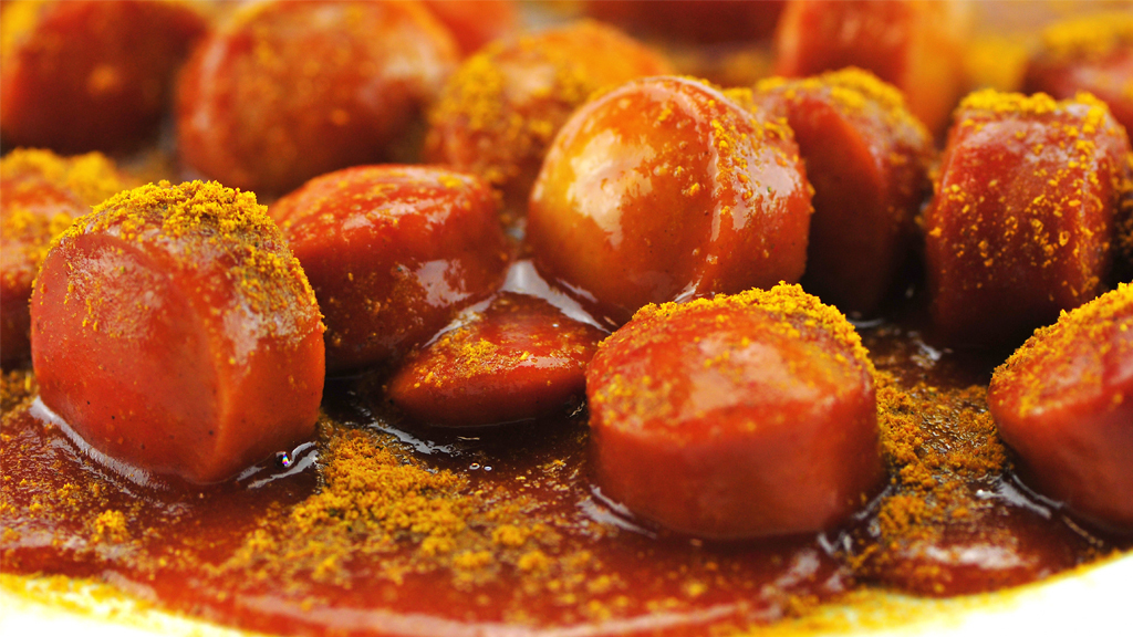 Currywurst is bratwurst freshly grilled and served with a huge dollop of ketchup and curry powder