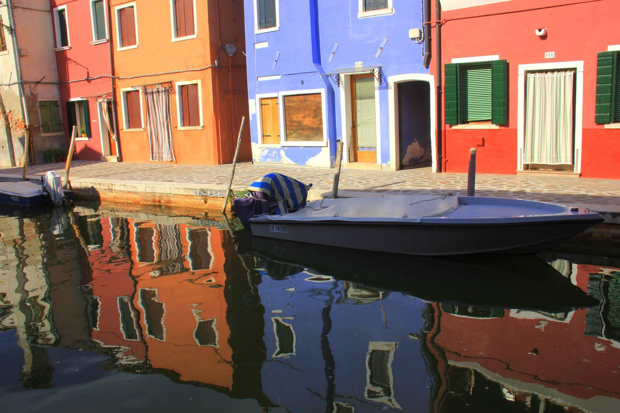 Reflections of houses in Burano island