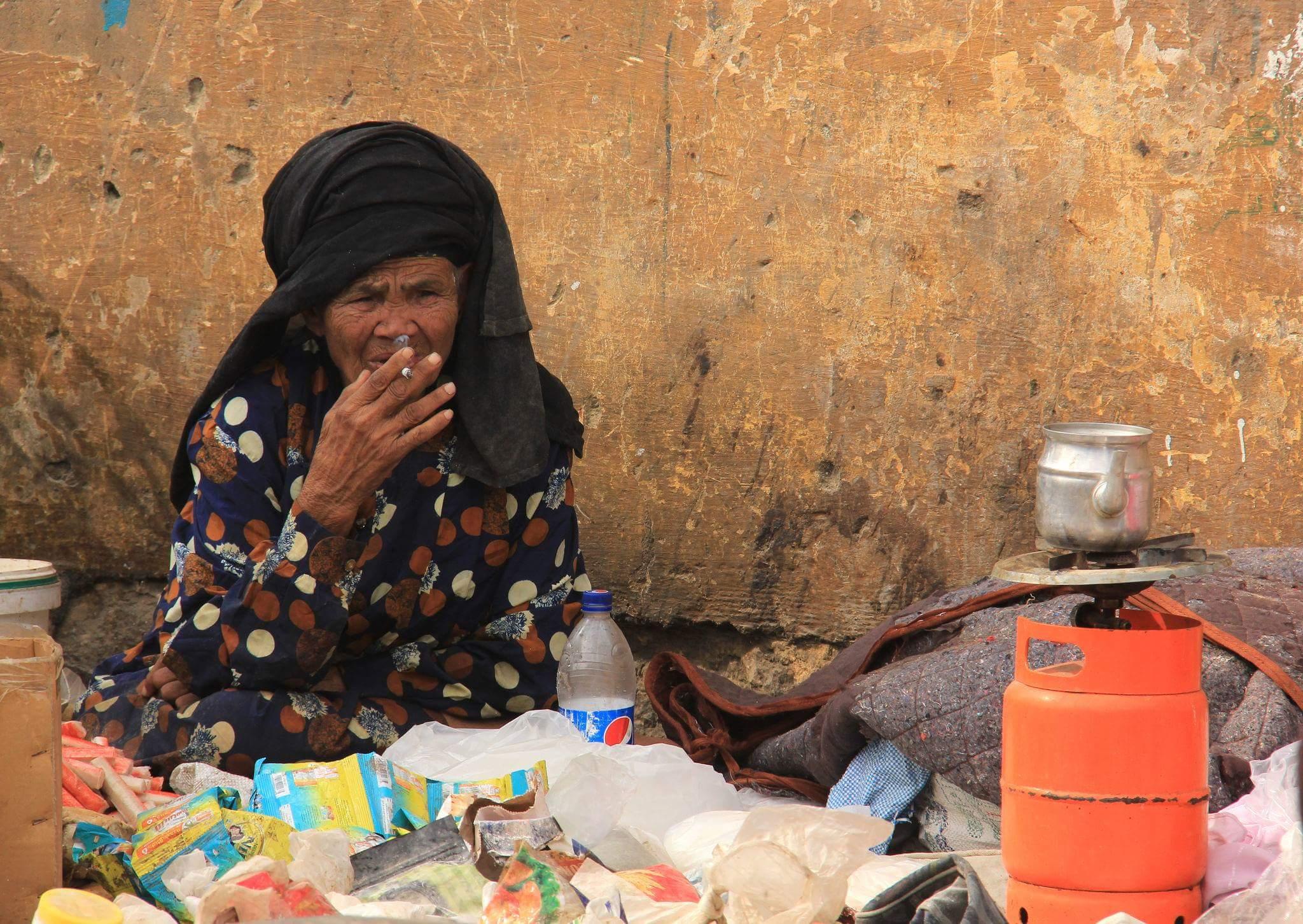 old seller at souq al goma