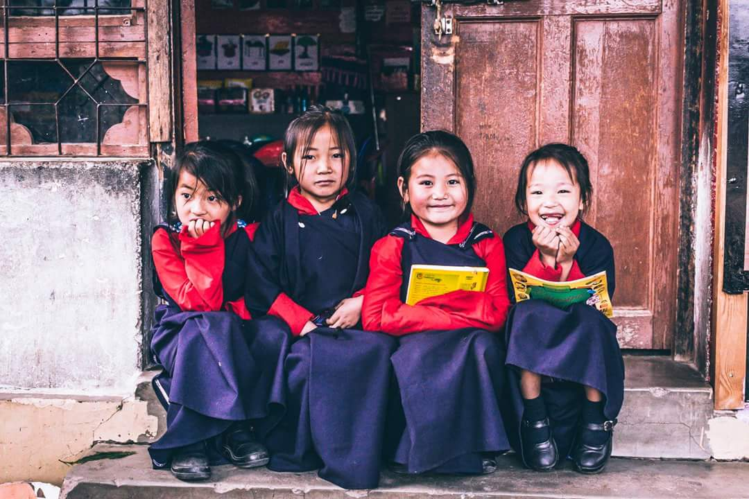 Happy children of Bhutan posing in Paro