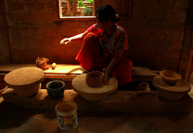 Woman making pots at lake inle