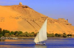 aswan guide points to a felucca ride