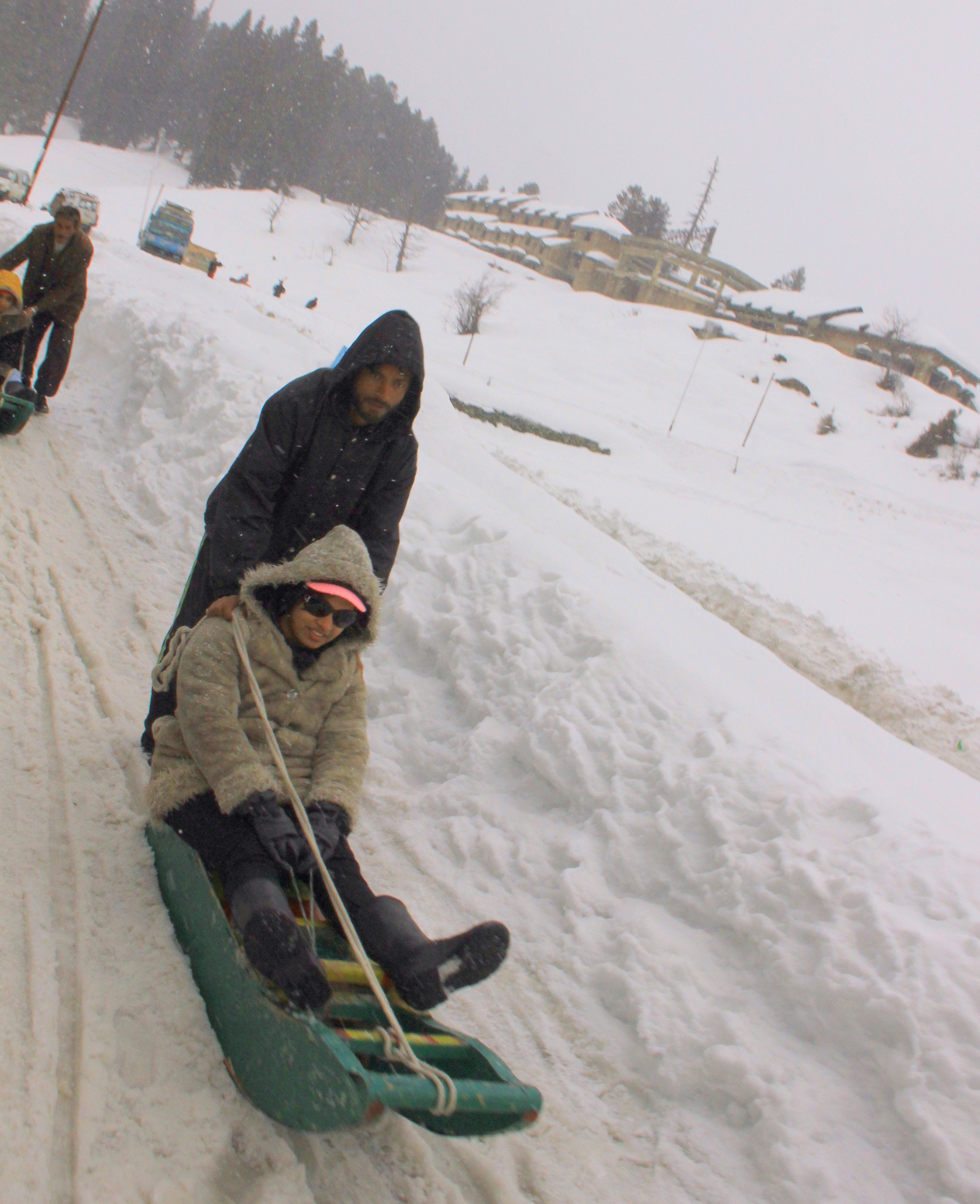 Sledding is popular in Gulmarg winter