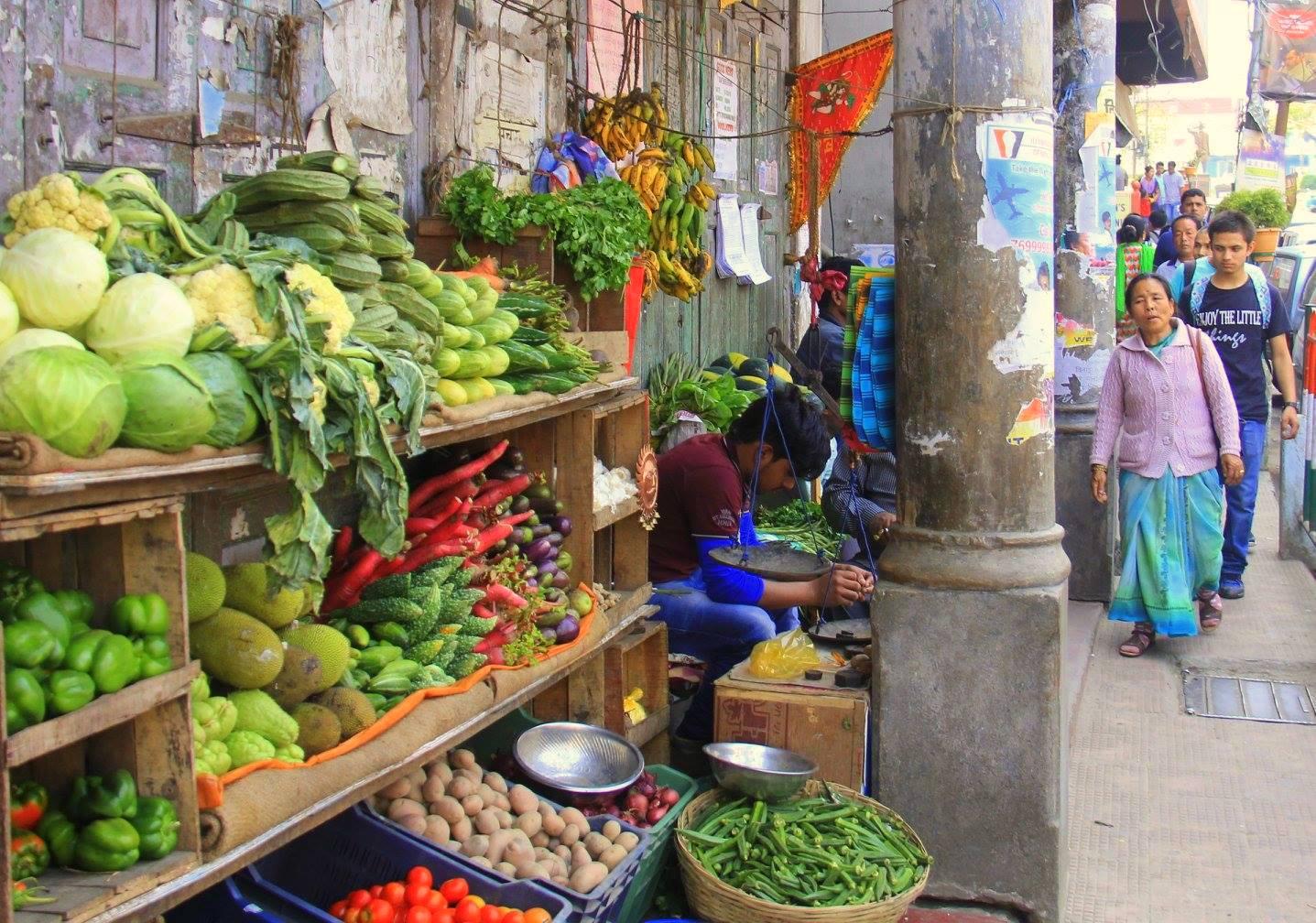 man selling vegetables in darjeeling local market