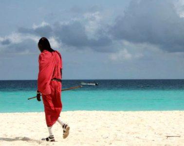 masai walking on nungwi beach