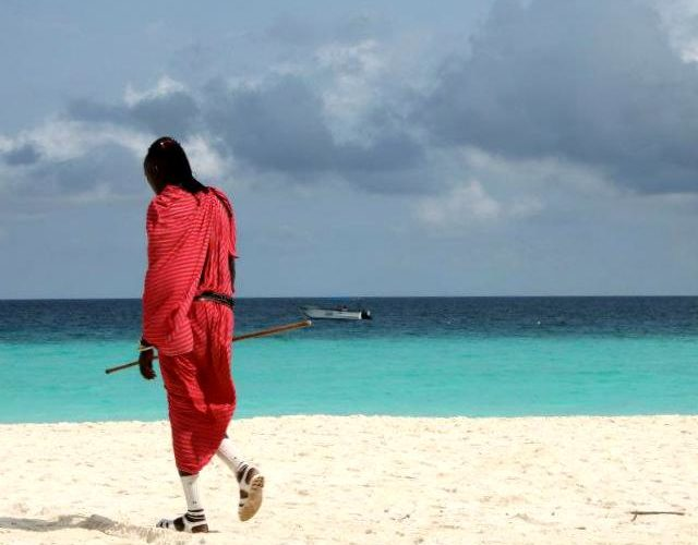 masai walking on nungwi beach
