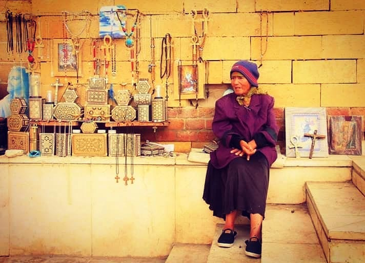 woman selling trinkets at coptic cairo