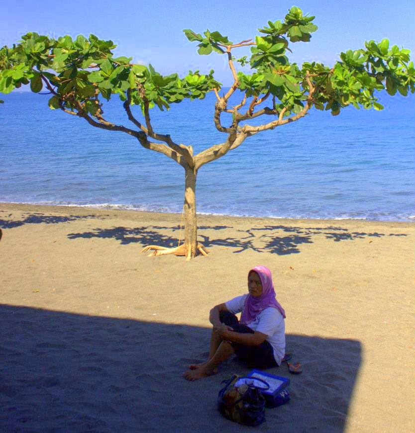 a local woman on a beach in Lombok