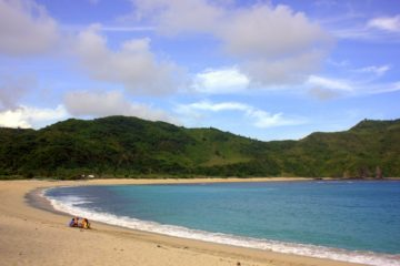 The perfect crescent of sand which marks Lombok beaches