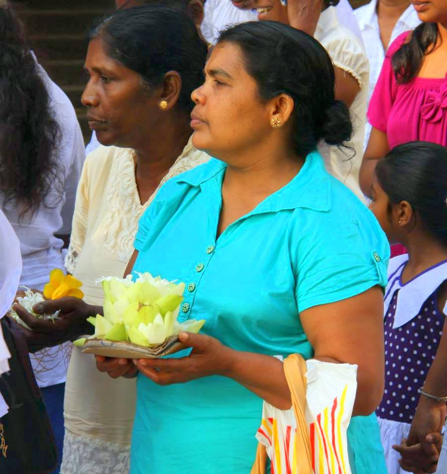 Devotees waiting in line at the Temple of the Sacred Tooth in Kandy