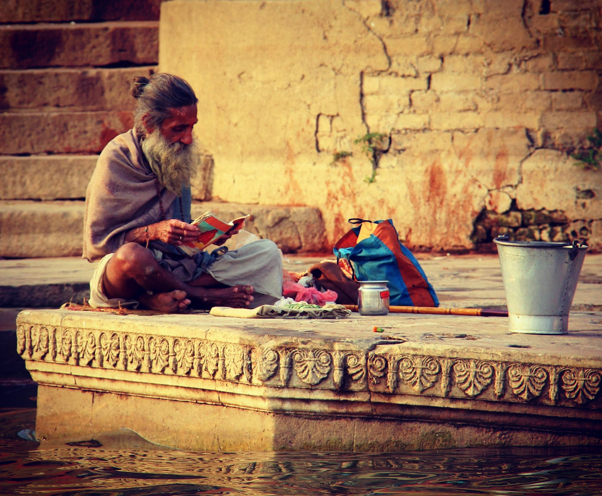 a holy man on the banks of the ganges in kashi