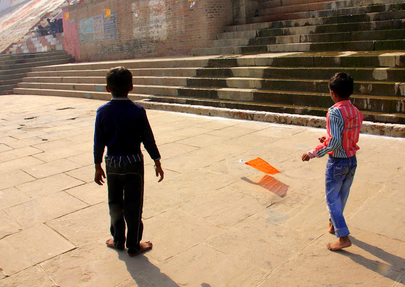 kids flying kite in kashi